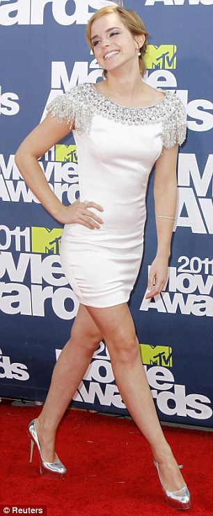 Britain V America: English actress Emma Watson struts confidently onto the red carpet at the MTV Movie Awards tonight but she had some hot competition in the form of American star Selena Gomez