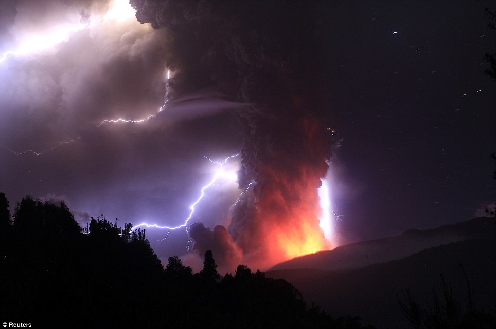 Incredible lightening bolts strike around the plume of volcanic ash and smoke
