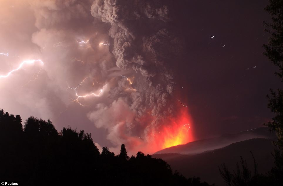 Smiling lightning: As molten rock and gases are ejected from the core of the volcano below, what appears to be a 'have a nice day' face is formed from the electrically charged air