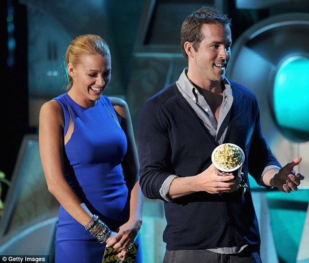 Presenters: Blake Lively and Ryan Reynolds had a ball as they presented the Best Kiss award to Robert Pattinson and Kristen Stewart