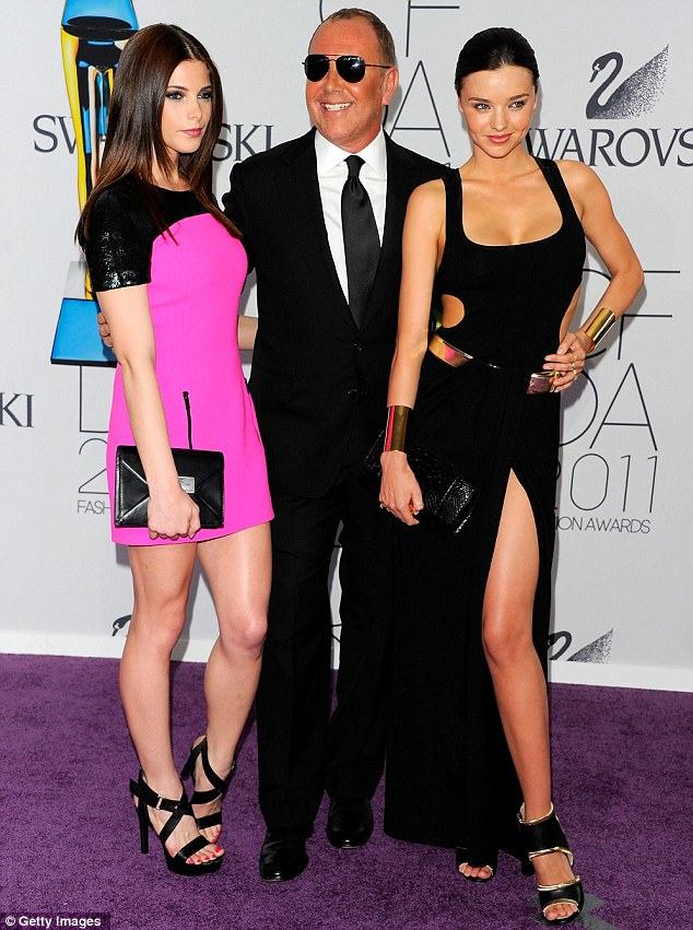 Say cheese: Twilight star Ashley Greene stood out in pink as she posed with designer Michael Kors and Miranda