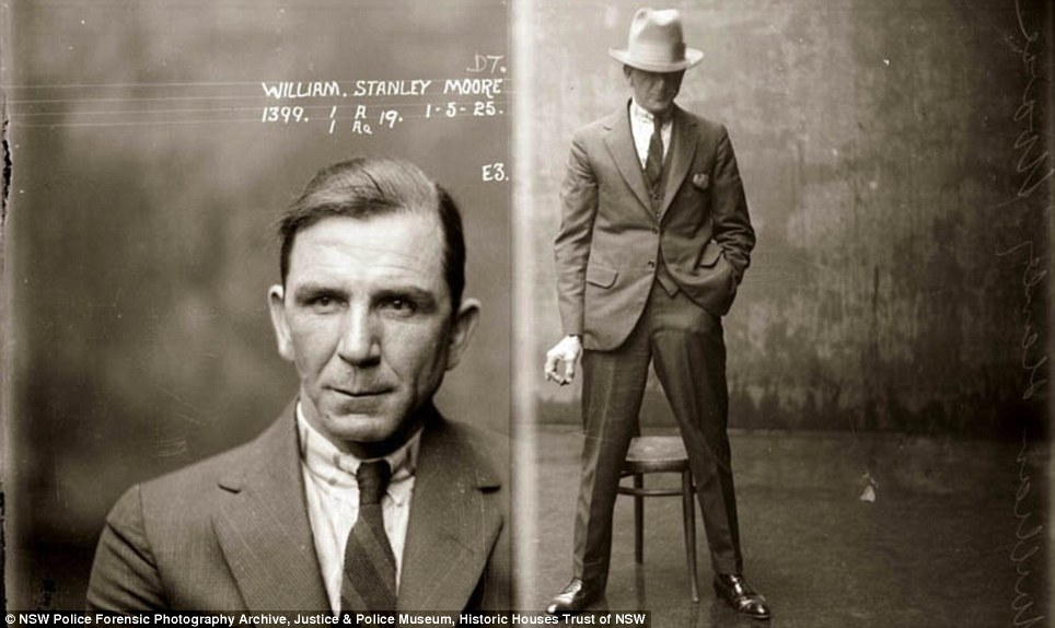 Brazen: William Stanley Moore is pictured on May 1st, 1925 with a cigarette in hand. He was described as an opium dealer who operated with large quantities of fake opium and cocaine. He also had associations with water front thieves and drug traders