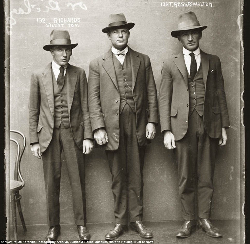 Triple trouble: 'Silent Tom' Richards and T Ross, alias Walton and an unknown man appear in this photo on April 12, 1920