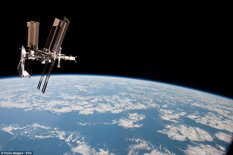 The ISS and the docked Endeavour in orbit over Earth. Nespoli's photo, taken last month, was the first taken of a shuttle docked at the ISS from the perspective of a Russian Soyuz spacecraft