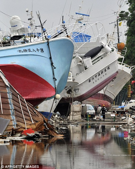 Pile up: Boats are still stacked against one another in Kesennuma, Miyagi prefecture, 100 days after the earthquake struck Japan