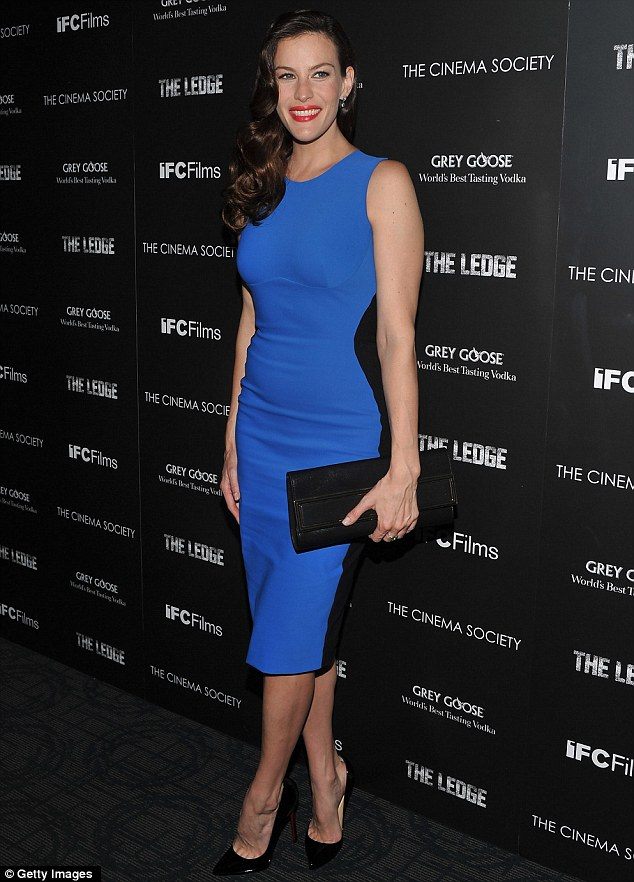 Wow: Liv Tyler looks stunning in a skin tight blue dress as she arrives at the première for her new film The Ledge