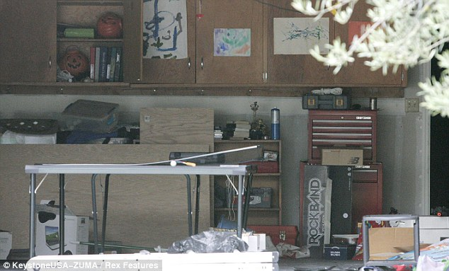 A normal family: Kyle and Sean's drawings decorate the garage of their home. The brothers were found dead in their bedrooms yesterday after their father shot them in a double murder-suicide