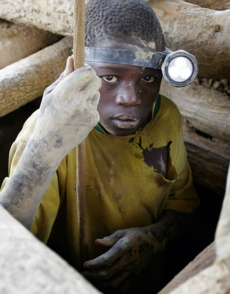 No place for a child: Massire Sijnate, 16, descends into a shaft at a gold mine near the village of Tenkoto, Senegal