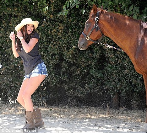 Trot on: The model appeared to be somewhat scared of the horse afterwards
