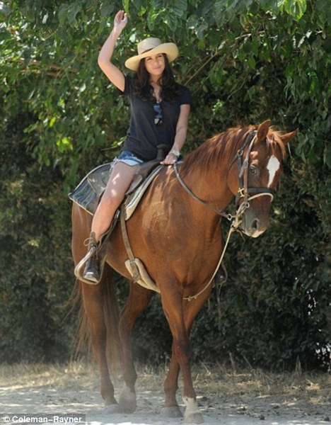 Howdy: Imogen had appeared fairly confident as she tried to ride the horse Western-style earlier