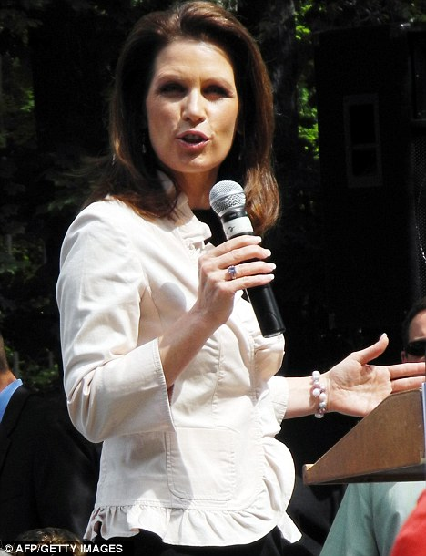 Under fire: Michele Bachmann at a meeting in Raymond, New Hampshire, today, as her former chief of staff attacked for a lack of leadership experience