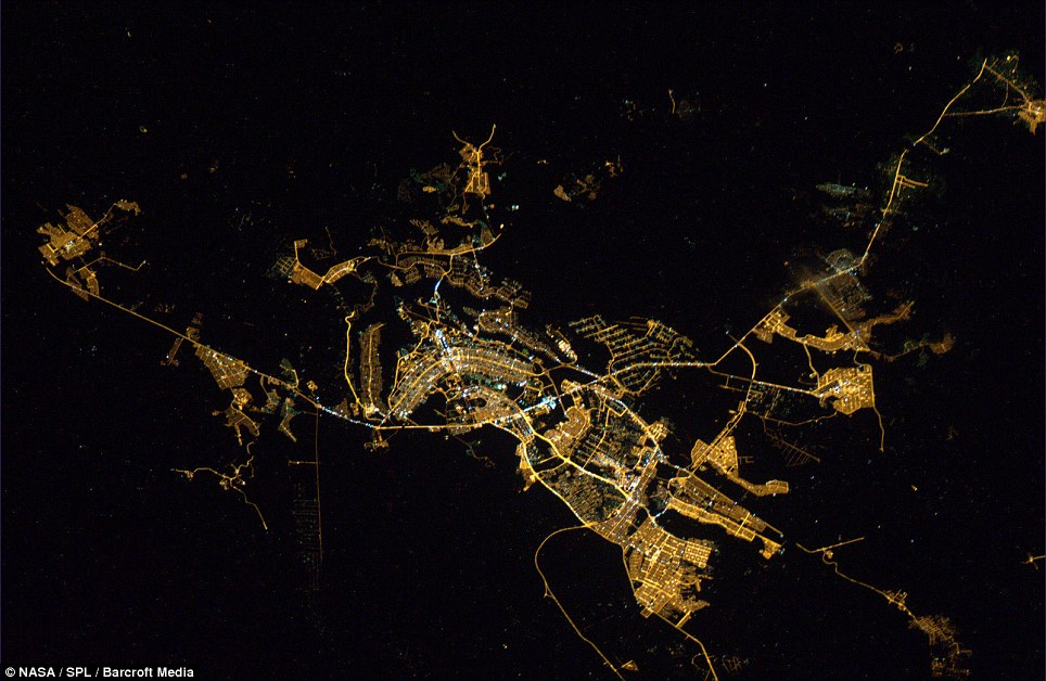 This photograph of Brasilia, Brazil shows a slightly less dense area of the population, neatly arranged around the city's main region