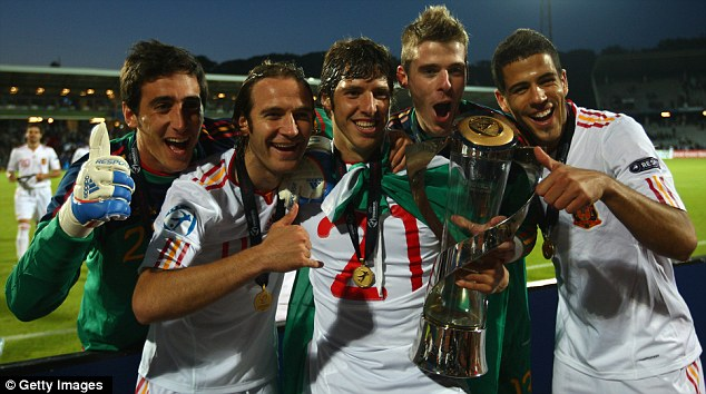Spanish starlets: De Gea (2nd right) celebrates with his team-mates after the Spanish youngsters' triumph
