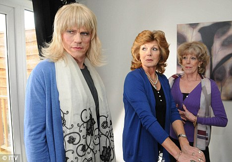 Love triangle: Cross-dressing Marc Selby became involved with Audrey Roberts, right, and Claudia Colby in one storyline