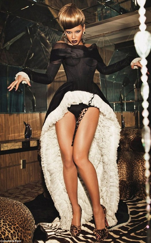 Tall order: Beyoncé poses in an incredible pants-and-thigh-baring corset dress and skyscraper leopard print heels in her latest sexy photoshoot