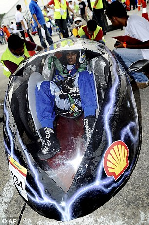 Fast as lightning: Malaysia's Mekamethan Govendarajoo squeezes into his helmet-like car