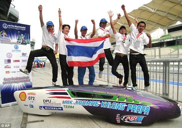 Jump for joy: Team Luk Jao Mae Khlong Prapa from Thailand's Dhurakij Pundit University celebrate after their victory
