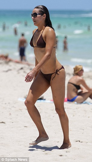 Soaking up the sun: Paula, who is actually in Miami working, and promoting her latest films, savoured her free time as she strutted around the beach
