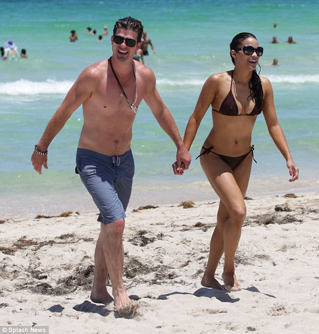 Coupled up: Paula and her husband R&B singer Robin Thicke walked hand-in-hand along the beach