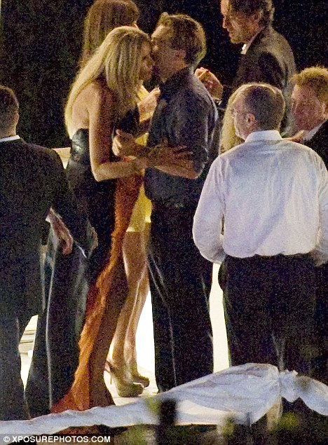 Care to dance? Leo moves in on yet another blonde on the dancefloor