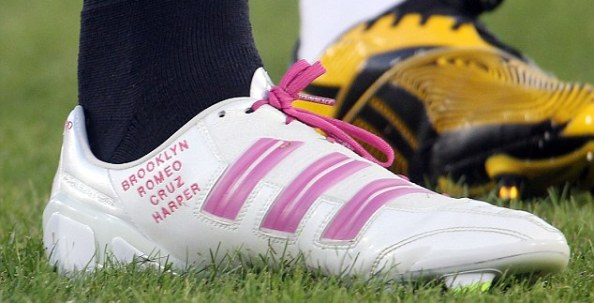 Pride and joy: Beckham has had new daughter Harper's name added to his boots