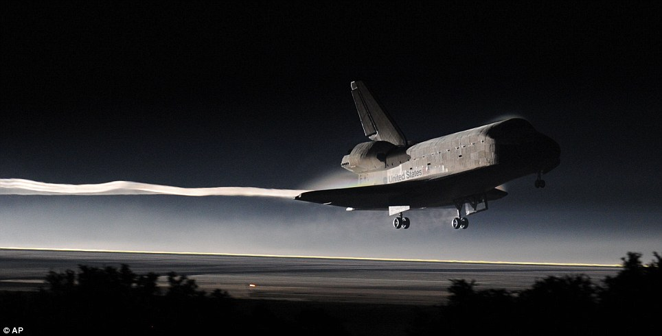 Touchdown: Atlantis lands at Kennedy Space Center one minute behind schedule at 5.57am (10.57am BST) today, bringing to an end Nasa's 30-year shuttle programme