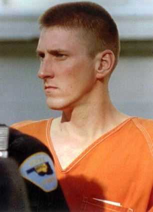 Authorities lead Timothy McVeigh, 27, to a waiting van in Perry, Oklahoma