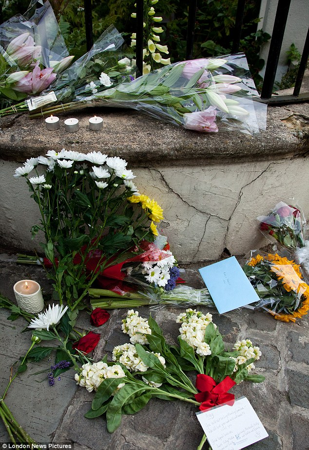 Mourning: Floral tributes are left outside Amy's house as news breaks of her death