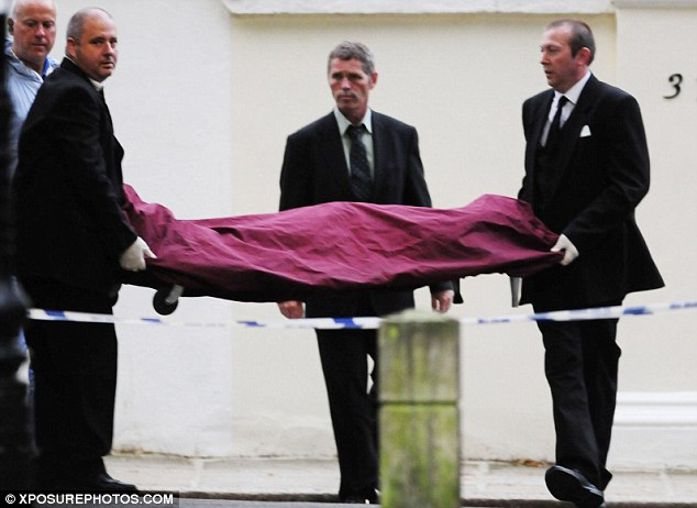 Tragic: Winehouse's body is seen being removed from her home
