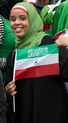 Proud: A young Somaliland woman holds her national flag