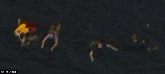 Escape: This picture shows people swimming away from the gunman who descended on the island of Utoya