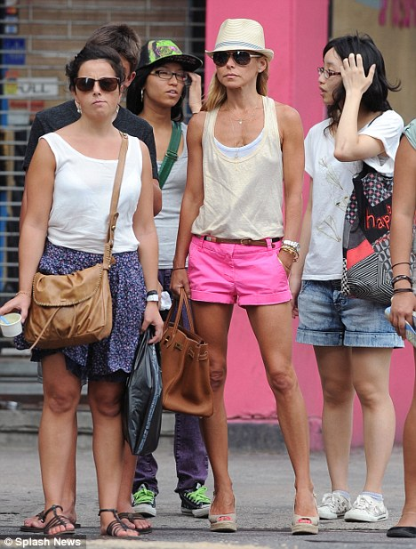 Kelly Ripa Stands Out From The Crowd In Hot Pink Shorts As