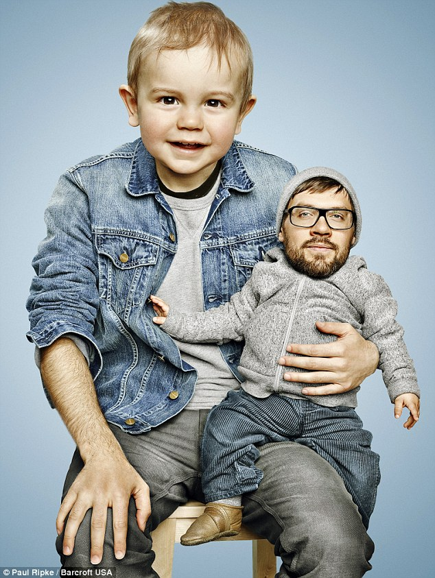 Roles reversed: A bearded baby sits on the knee of his fresh-faced father