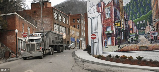 Migrating: A coal truck drives out of downtown Welch, West Virginia, which is one of the worst hit states for losing its population