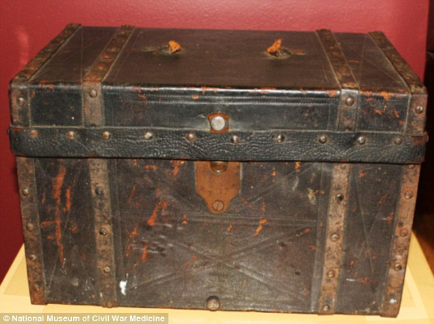 This apothecary chest contains medicines in paper envelopes and glass medicine bottles