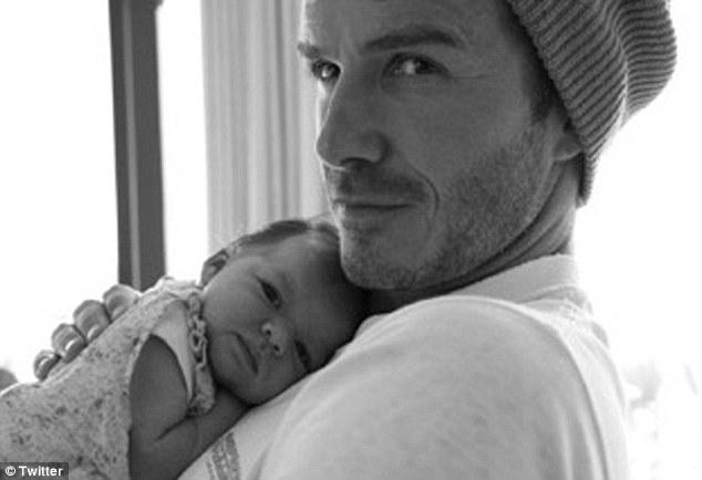 Victoria Beckham tweets photo of David holding Harper ...