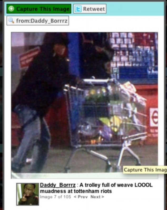 Looter: Pictures put on Twitter showed some of the rioters using shopping trolleys to carry away stolen items including TVs and mobile phones