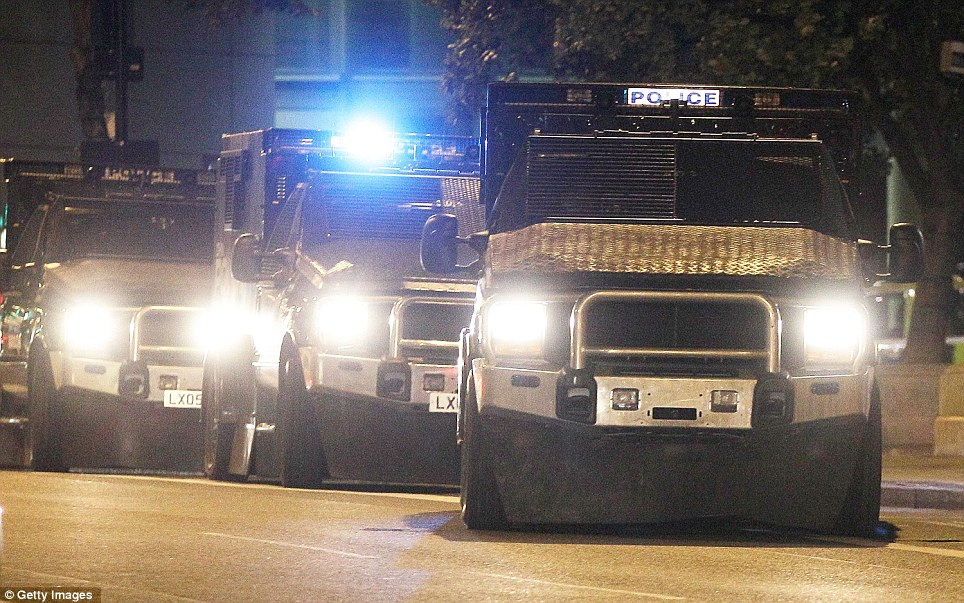 Under control: Heavily protected and looking menacing, police 'Jankel' riot wagons patrol Hackney centre to prevent further disturbances last night