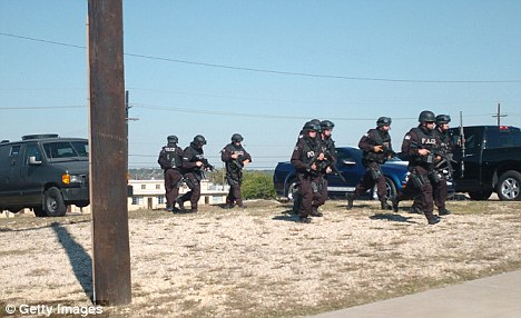 Chaos and carnage: SWAT teams converge on a building during the Fort Hood massacre which left 13 people dead