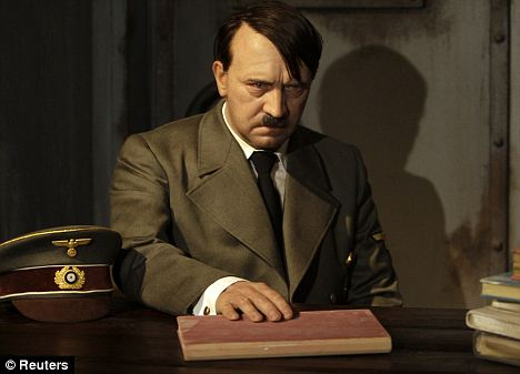 Near the end: A wax figure of Hitler sits in a mock bunker at the German Madame Tussauds in Berlin. It is illegal to glorify the Nazi leader there