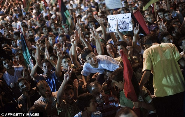 Thousands of people gathered in central Benghazi last night following the news from Tripoli