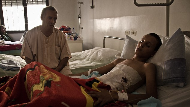 Wounded: As the wounded and dead fill Tripoli's hospitals Nisreen begs to be taken of