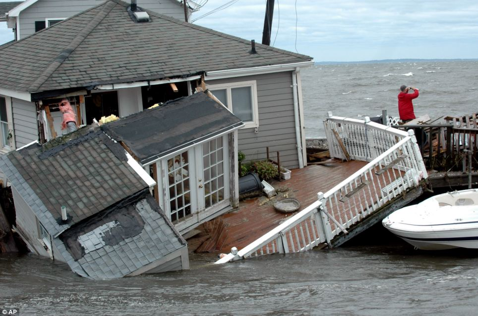 Toppled: A Fairfield Beach Road home is submerged in Pine Creek in Fairfield, Connecticut as treacherous weather caused by Tropical Storm Irene came through the area on Sunday