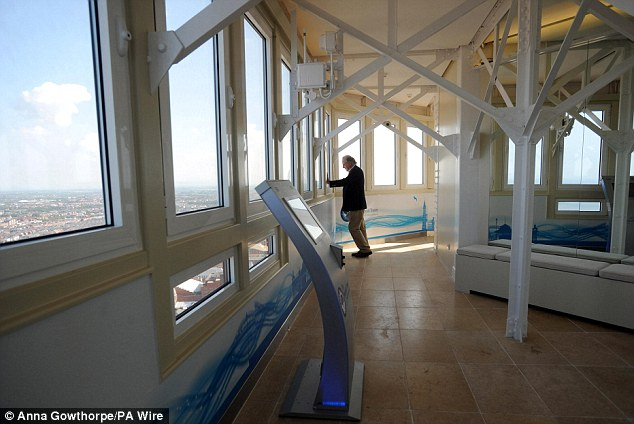 Old and new: A visitor admires the vantage point in the new viewing gallery that brings the 19th century building right up to 2011