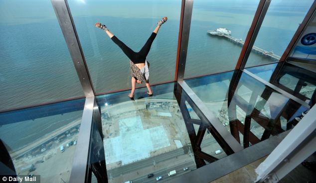 Topsy-turvy: Jessica Hill, eight, from Blackpool does a handstand on the glass floor