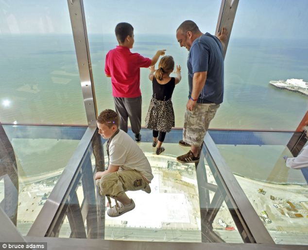 Walking on air: Jessica, Oliver, Josh and Anthony Hill from Blackpool look down through the glass floor