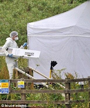 Forensic staff at the scene of Raoul Moat's suicide at the riverside in Rothbury after evading capture for a week