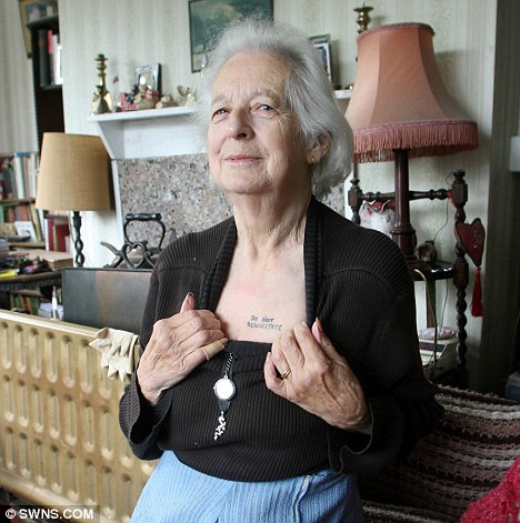 Right to die: Grandmother Joy Tomkins, 81, shows off the 'Do Not Resuscitate' tattoo which she had written across her chest for paramedics in case she falls unconscious