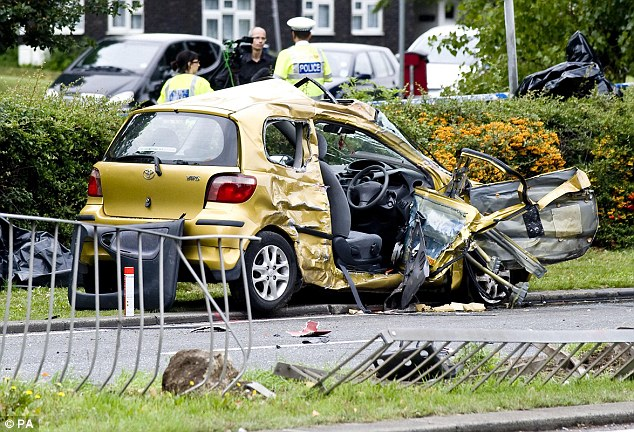 Wrecked: The crushed remains of the woman's car in Basildon, Essex is left on the roadside