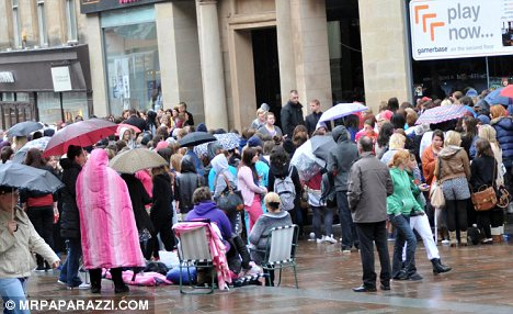 Dedication: Fans queued outside the HMV store in Scotland in the pouring rain for their chance to meet Niall Horan, Zayn Malik, Liam Payne, Harry Styles and Louis Tomlinson